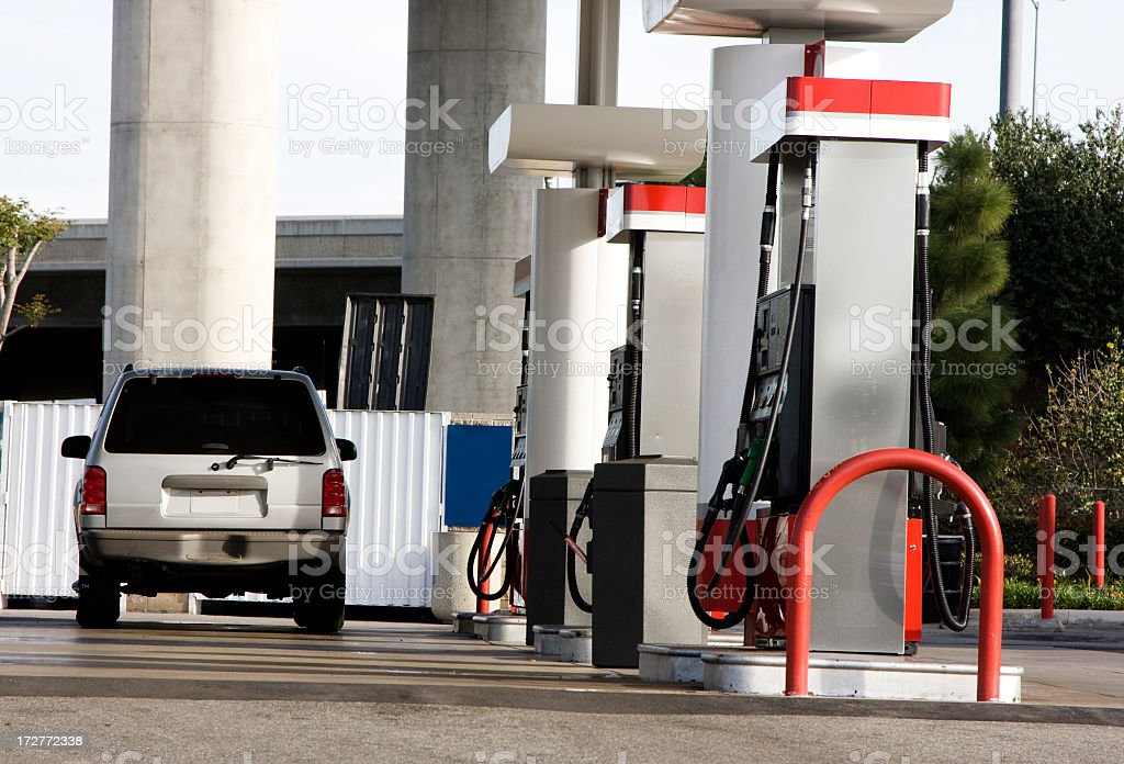 A car at the gas stations no pumps in use stock photo