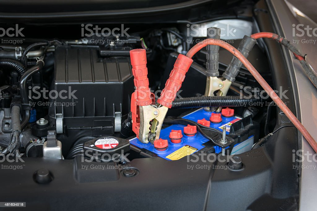 car battery charging stock photo