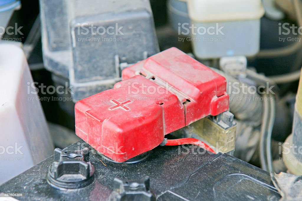 Car battery with red positive polarity for auto concept stock photo
