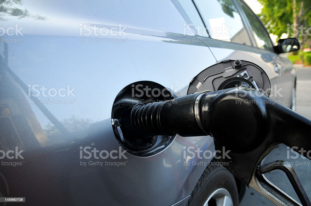 Car being filled up at the gas pump stock photo