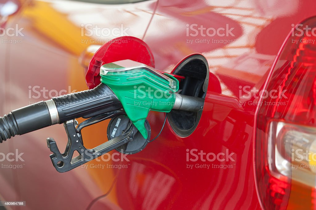 Car being filled with fuel stock photo