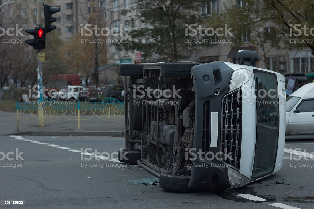 car bottom turned on the side after road collision stock photo