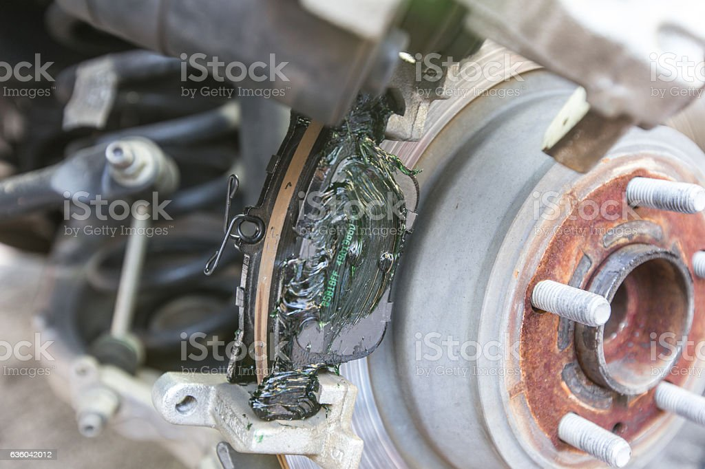 Car brake pad and disc with caliper stock photo