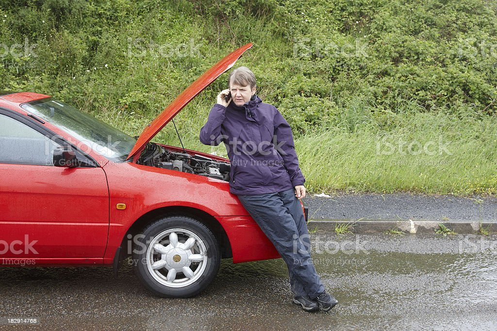Car breakdown woman waiting on cellphone royalty-free stock photo