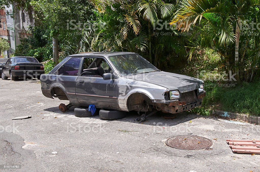 Car broken, crumpled and abandoned in Sao Paulo city stock photo