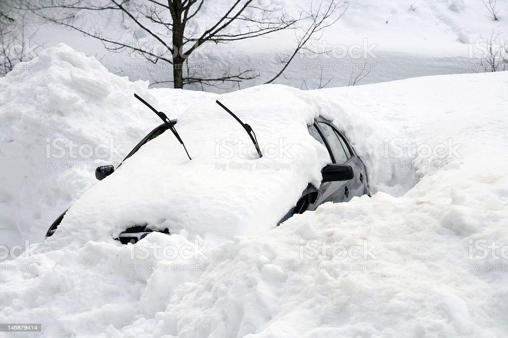 Car buried under large snowdrift stock photo