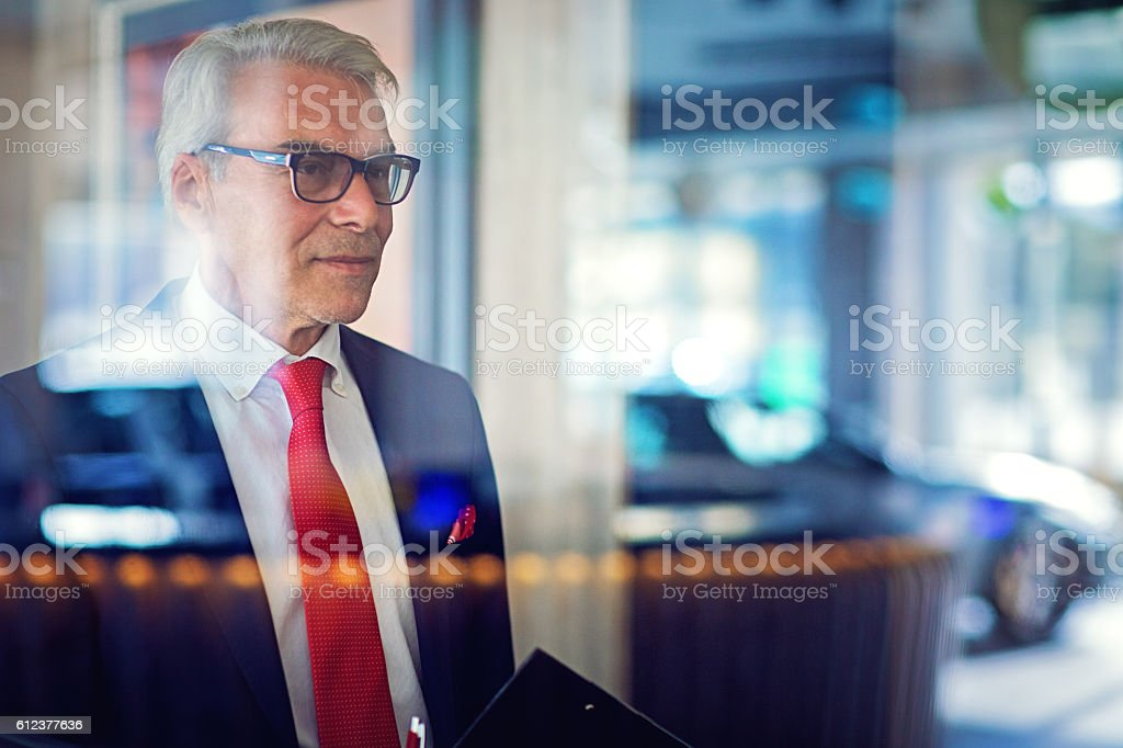 Car business owner in the showroom stock photo
