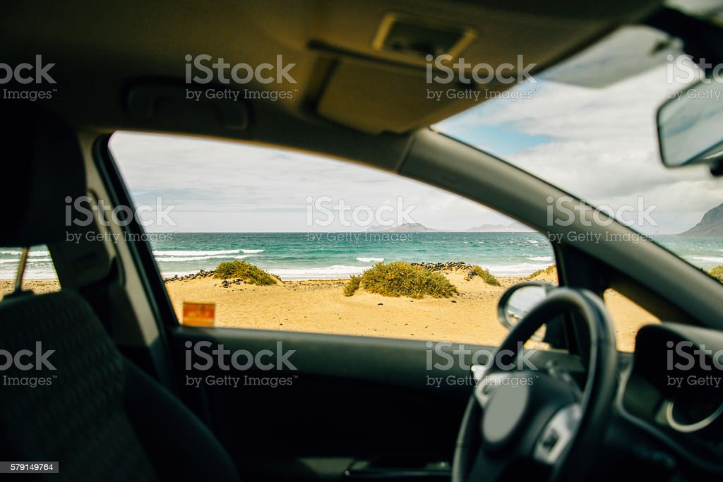 Car by the beach stock photo