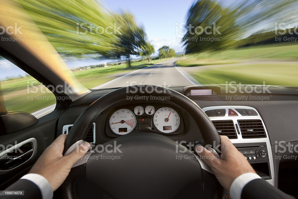Car cabriolet interior with man in suit driving fast royalty-free stock photo