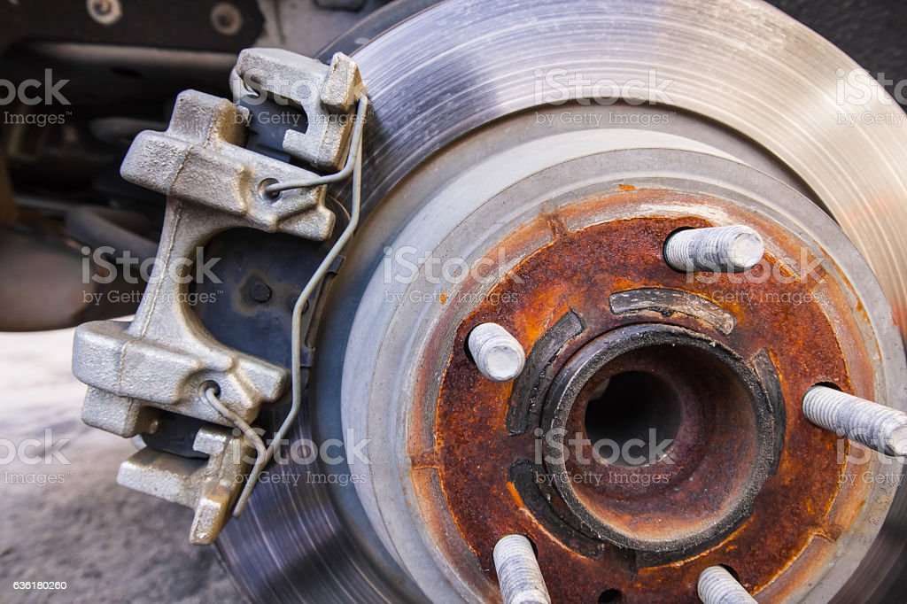 Car caliper with suspension and brake pads stock photo