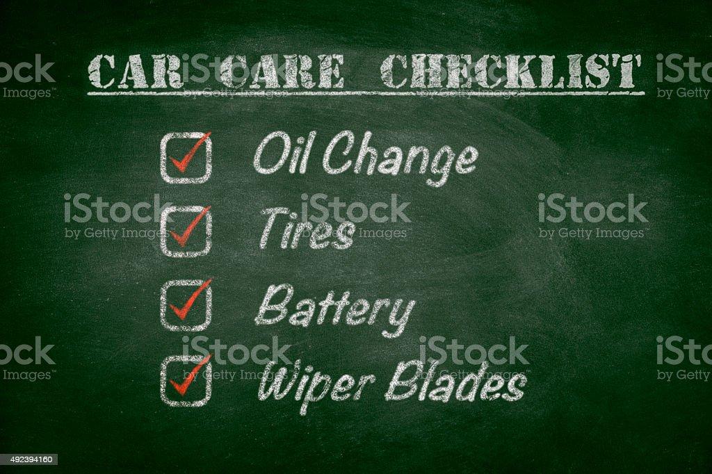 car care checklist on blackboard stock photo