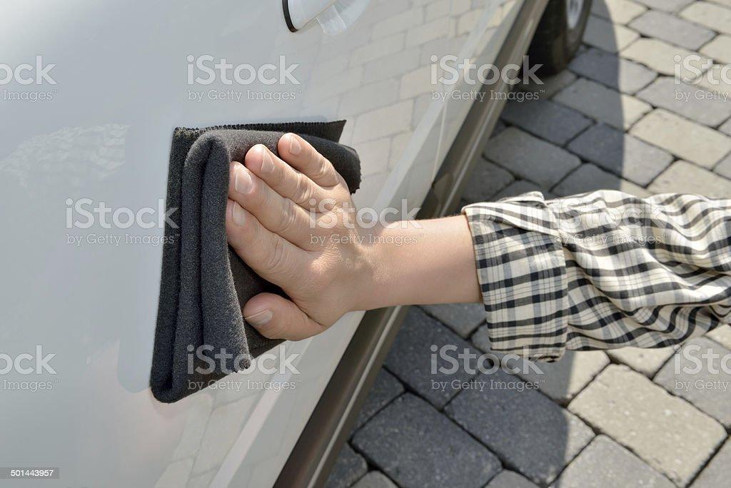 Car Care - Polishing a white Car stock photo