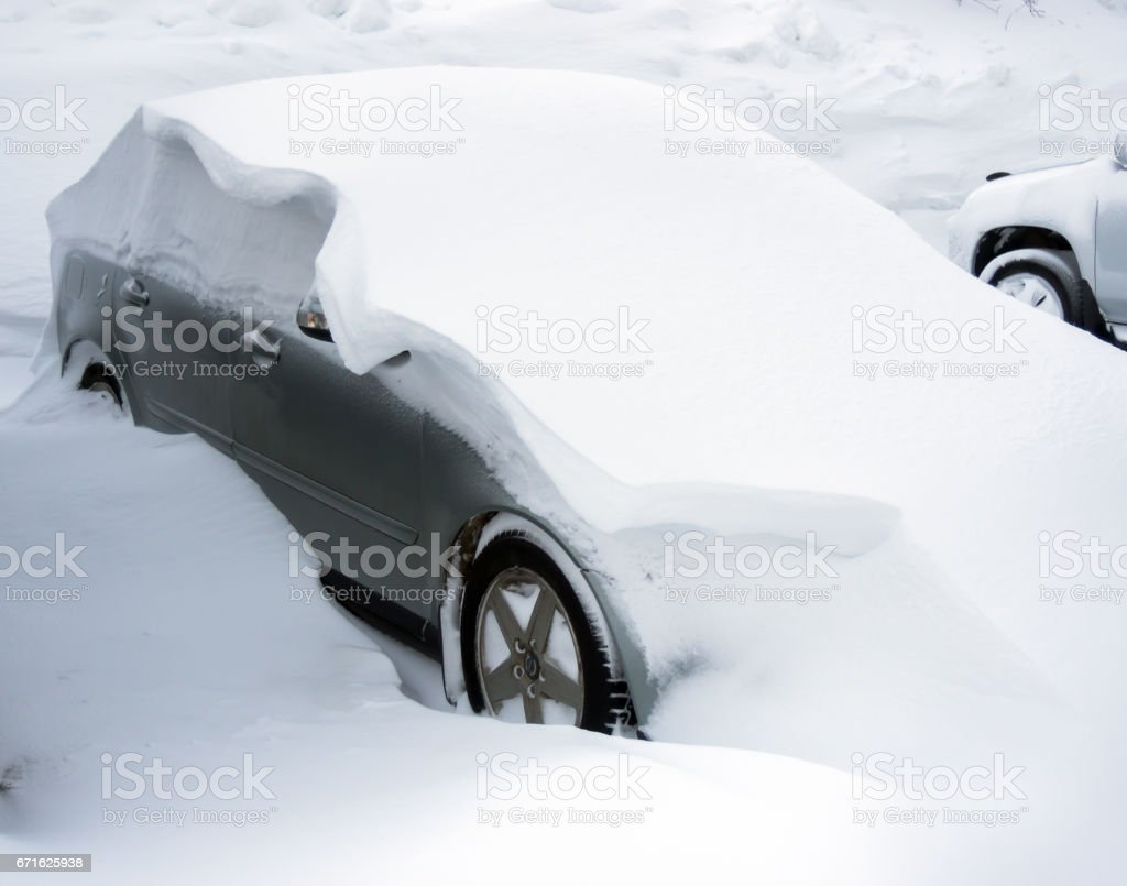 A car carried by snow in a snowdrift stock photo