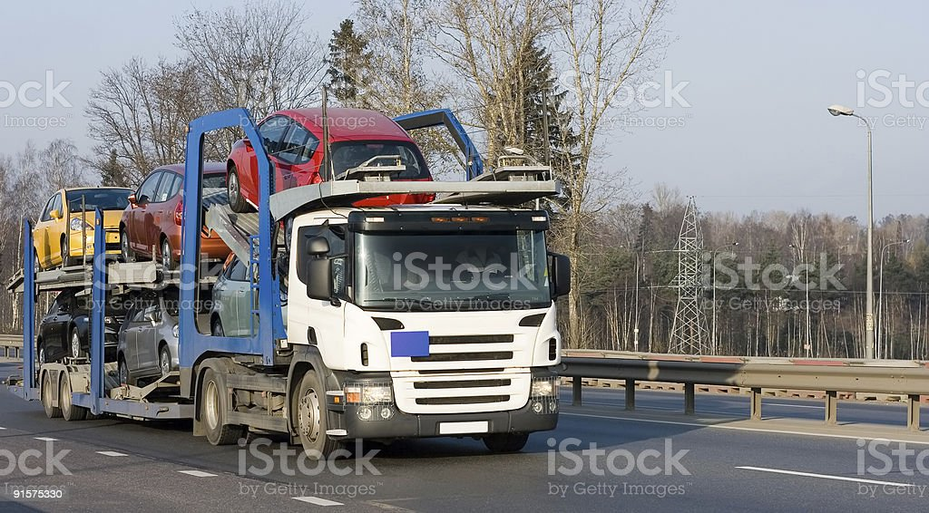 car carrier truck deliver auto batch to dealer: 'Trucks' series stock photo