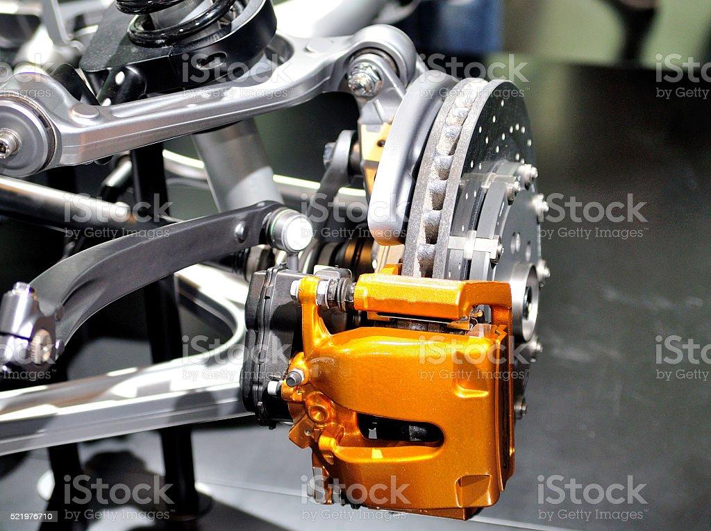 Car ceramic disc brake with yellow caliper. stock photo