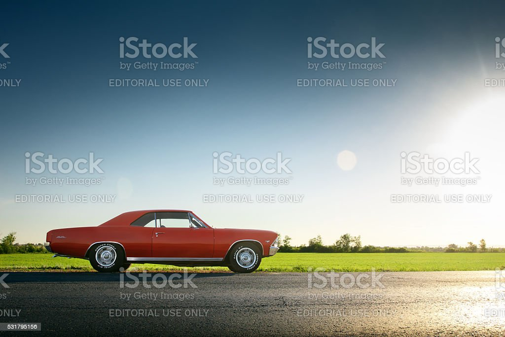 Car Chevrolet Malibu stay on asphalt road at sunset stock photo