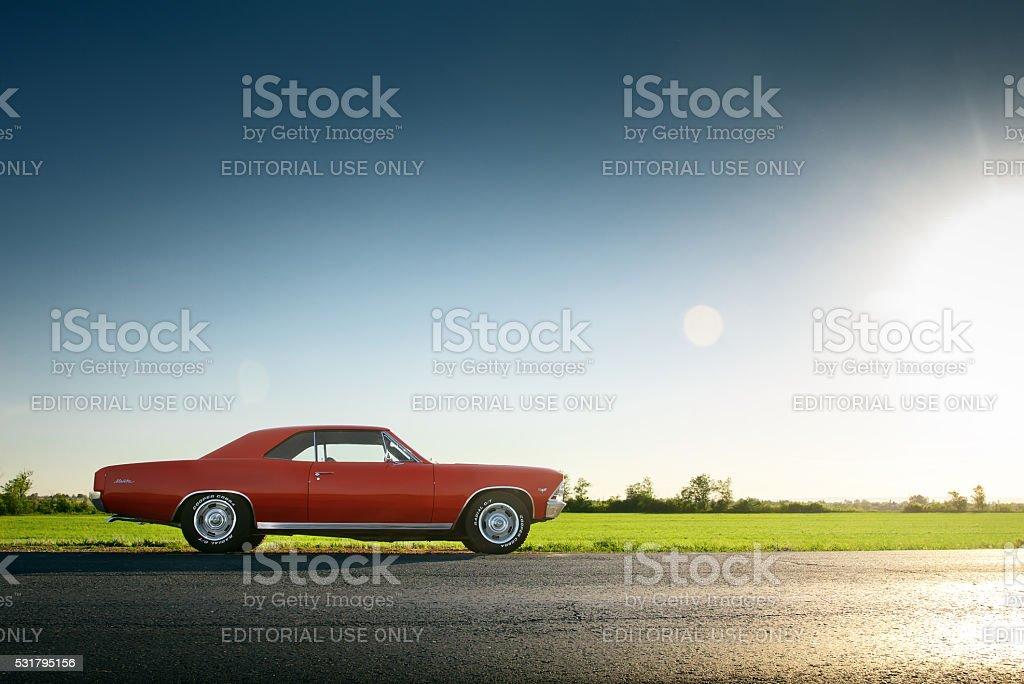 Car Chevrolet Malibu stay on asphalt road at sunset stock photo