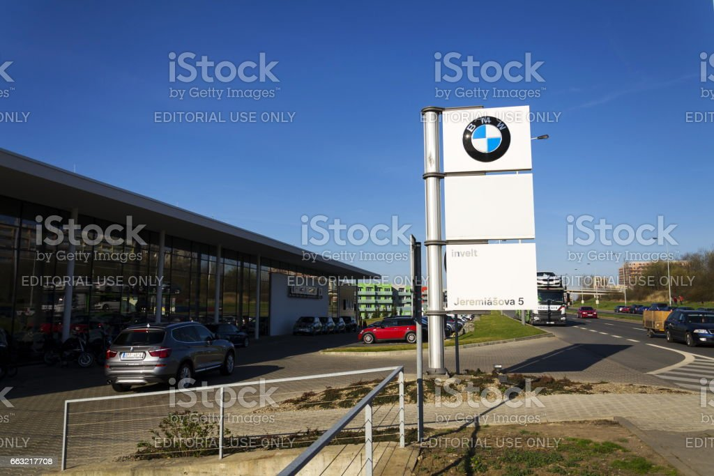 BMW car company logo in front of dealership building stock photo