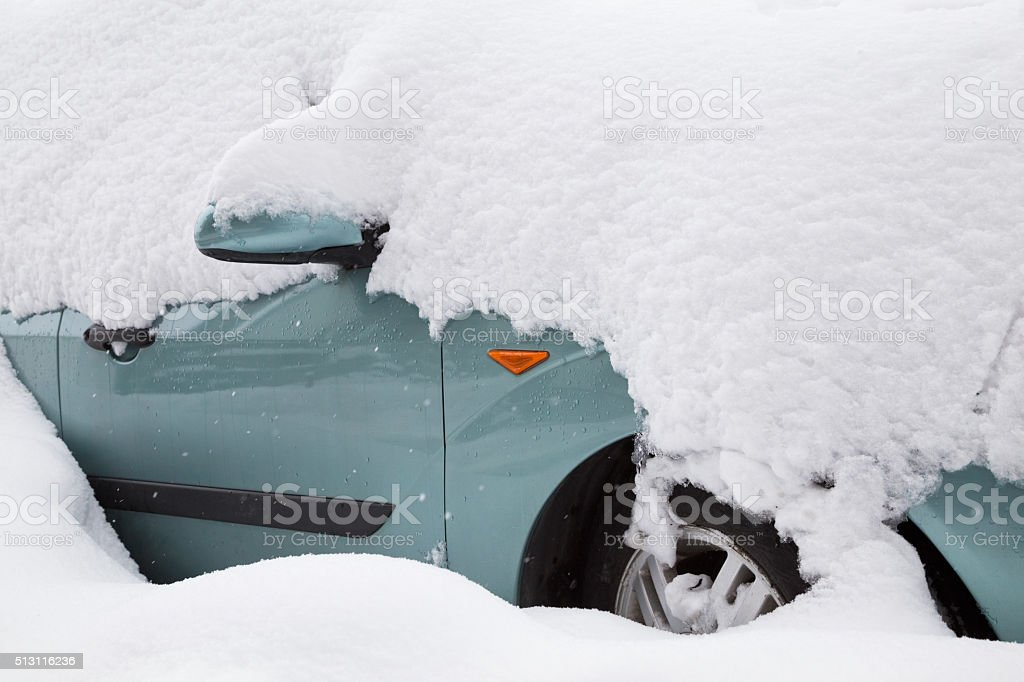 Car covered with big snow stock photo