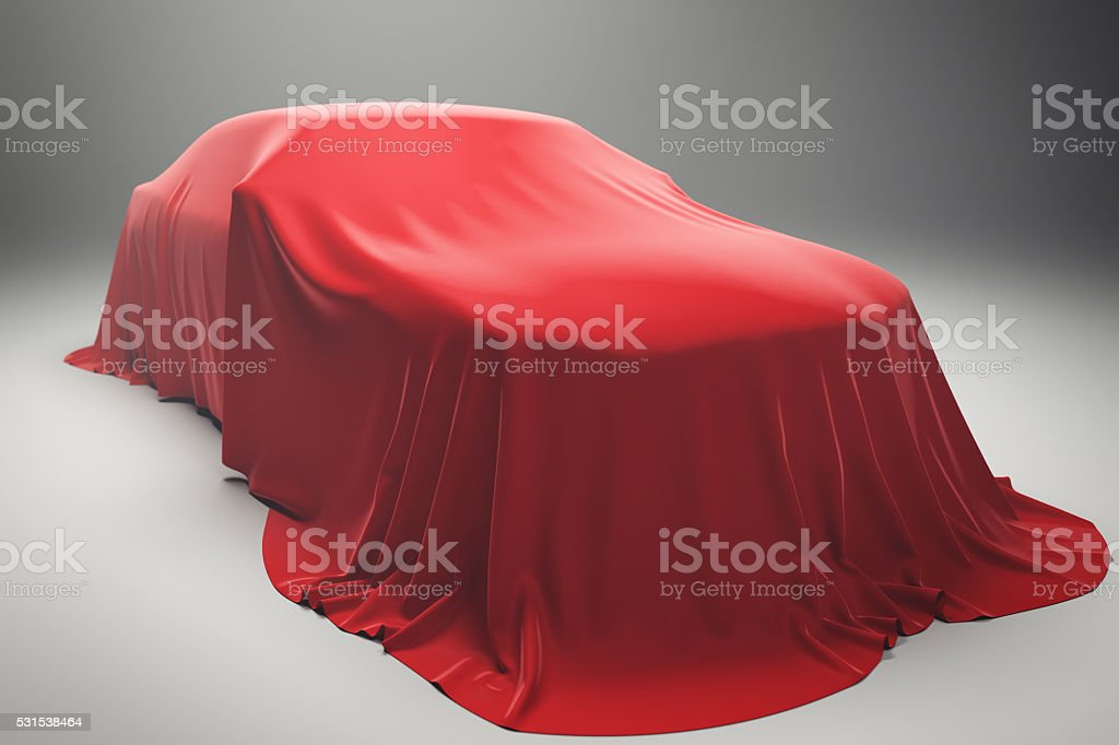 Car Covered With Red Velvet Cloth stock photo