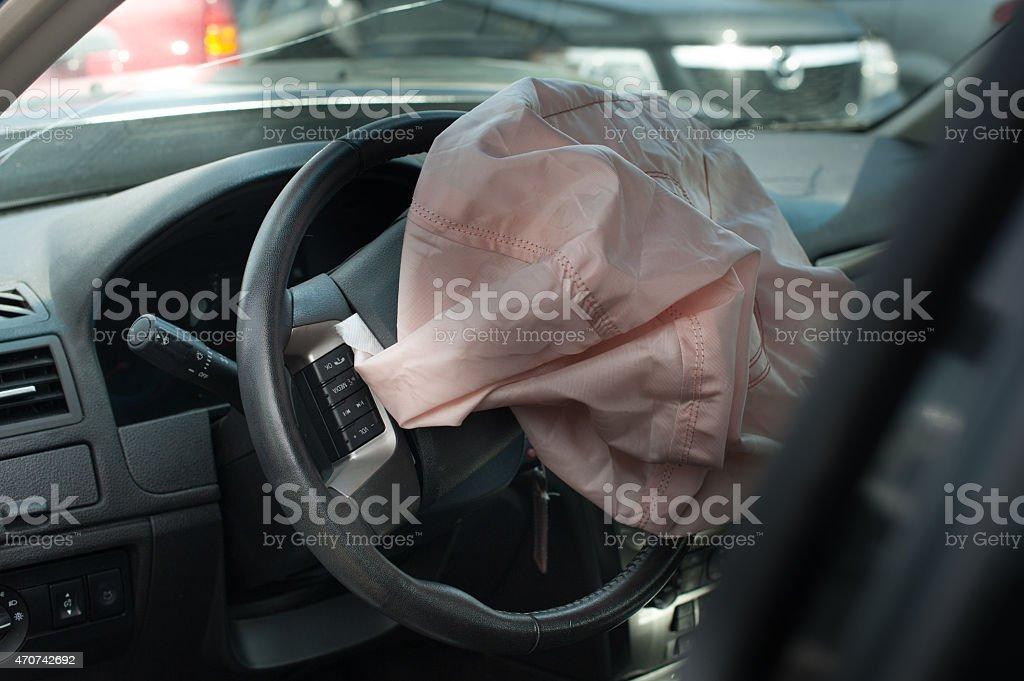 car crash accident on street, damaged car air bag stock photo