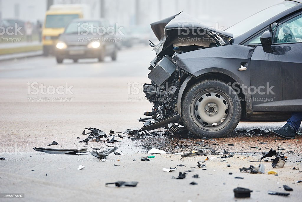 Car crash in urban street with black car stock photo