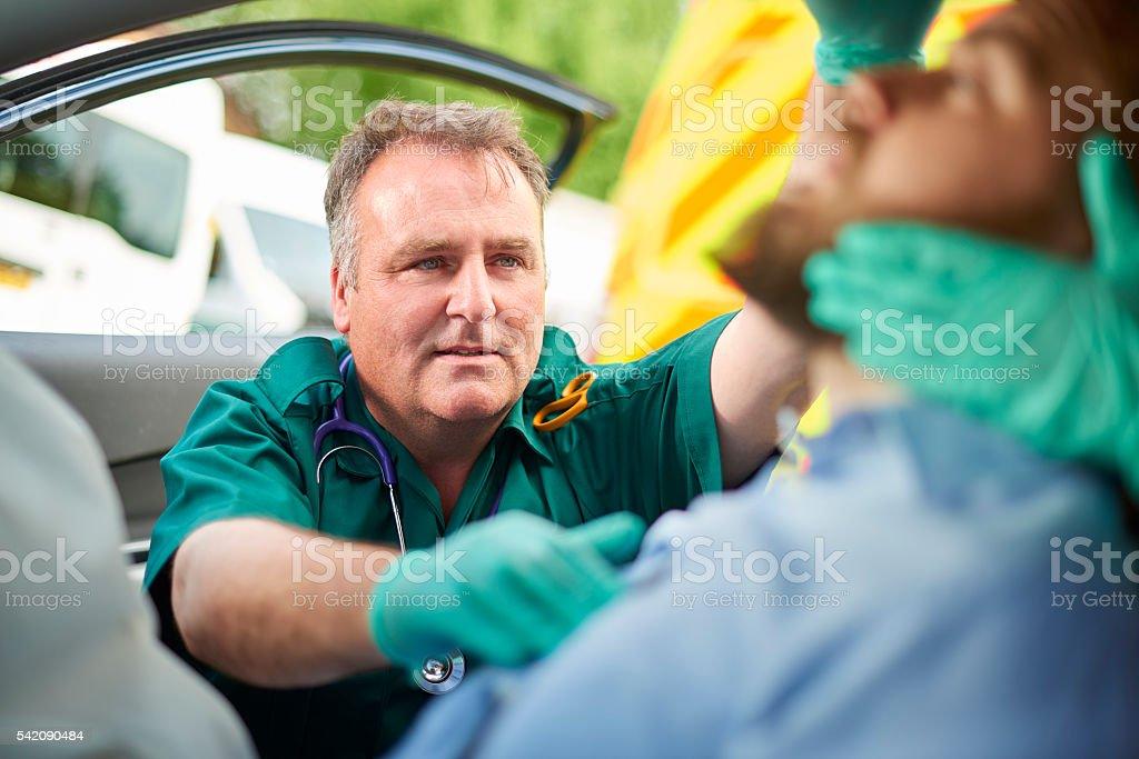 car crash medical attention stock photo
