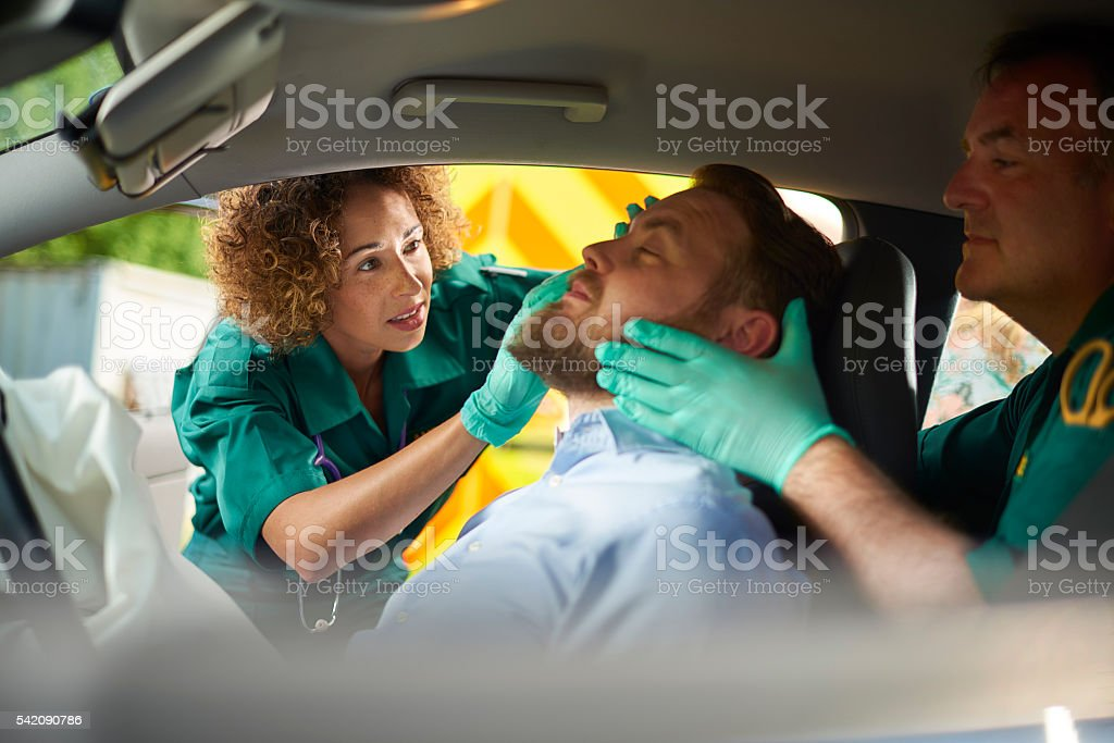 car crash medics stock photo