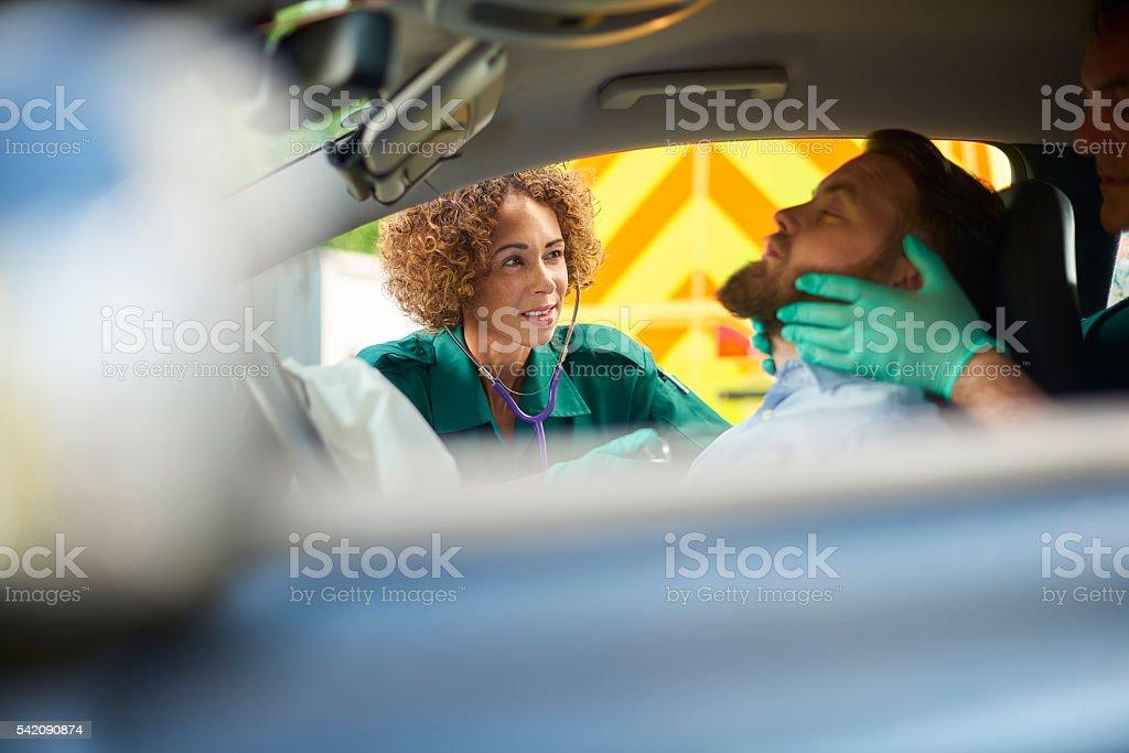 car crash paramedic stock photo
