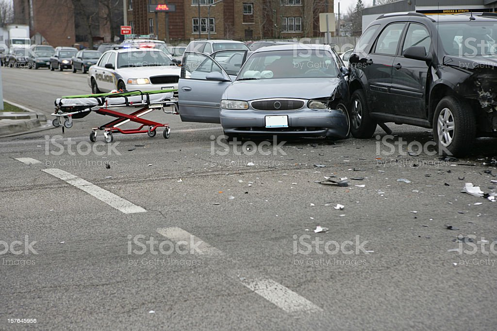 Car crash with a stretcher and a police car stock photo