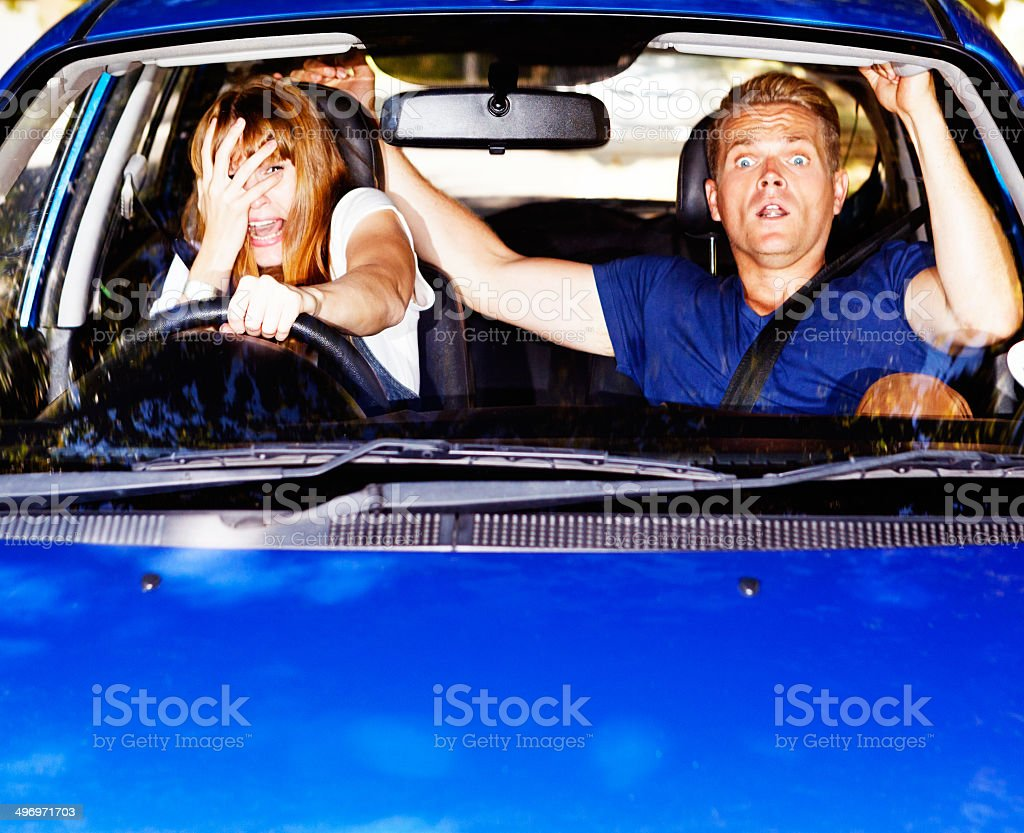 Car crisis! Young couple try to avoid collision stock photo