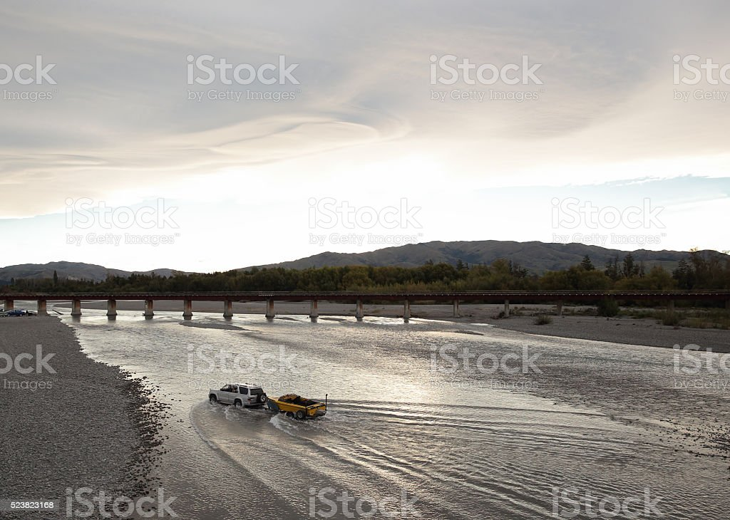 4WD car cross river in Kaikoura, South Island (NewZealand) stock photo