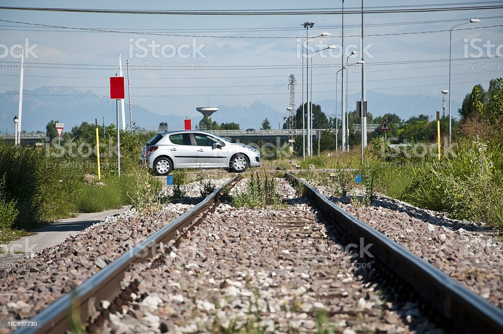 car crosses a level crossing stock photo
