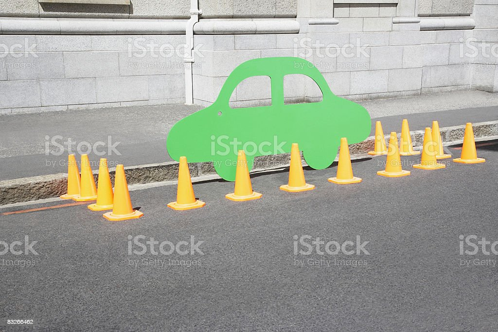 Car cutout and traffic cones on urban street stock photo