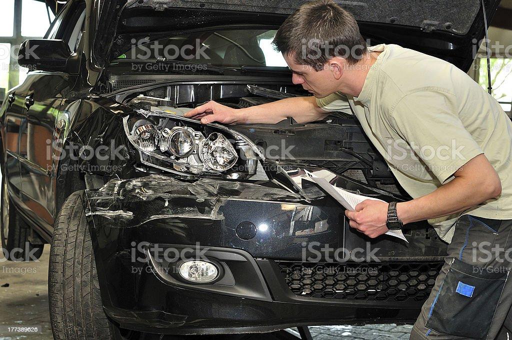 Car damage examining. royalty-free stock photo