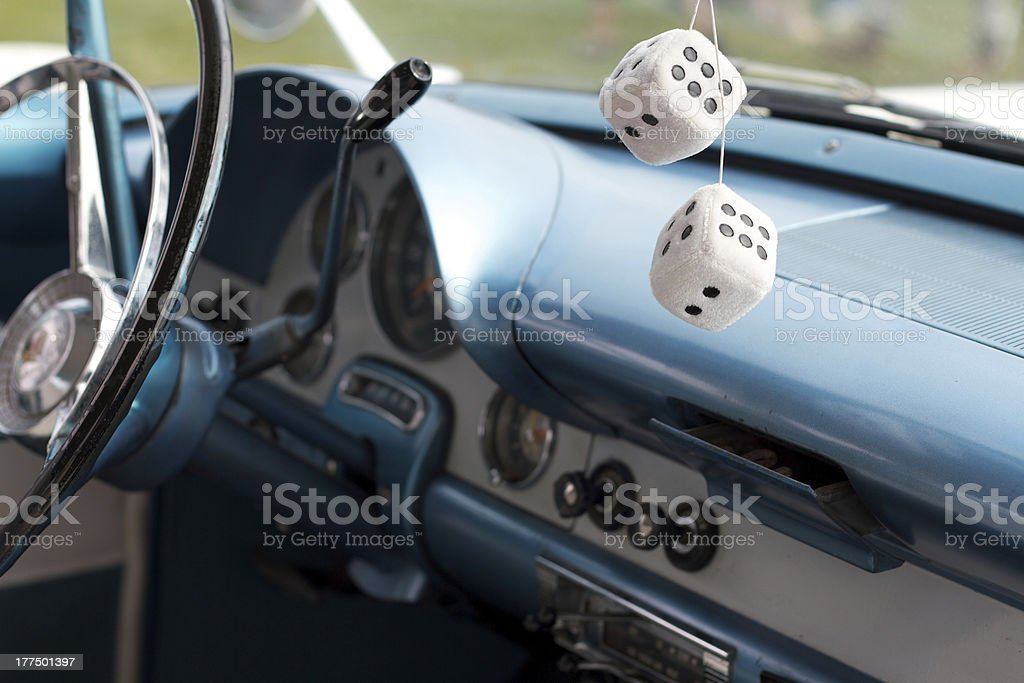 car dashboard and fuzzy dice stock photo