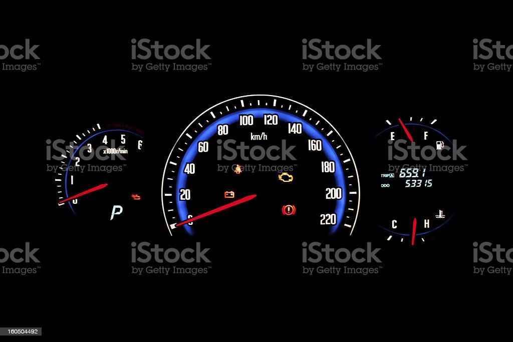 Car dashboard gauges illuminated at night. royalty-free stock photo