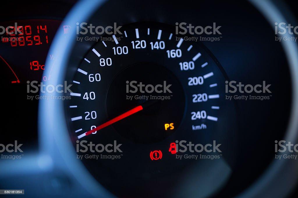 Car dashboard odometer night view stock photo