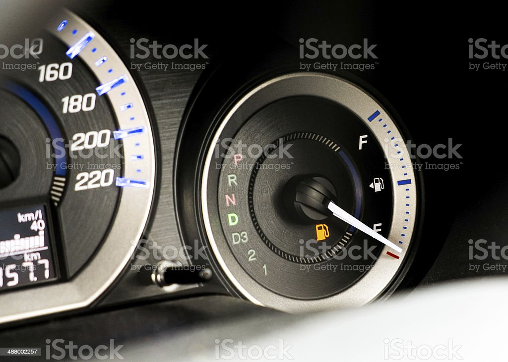 Car Dashboard - running out of gas stock photo
