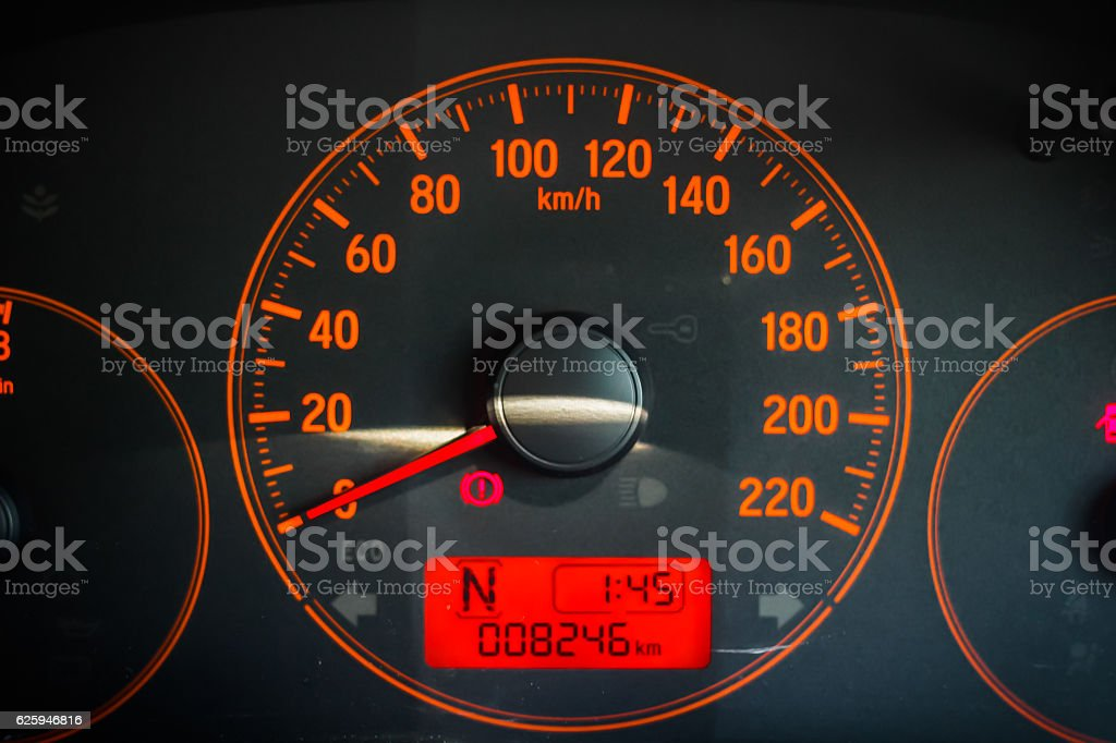 Car dashboard with speedometer, odometer and tachometer and indicator lights stock photo