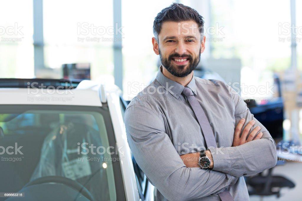 Car dealer in showroom stock photo