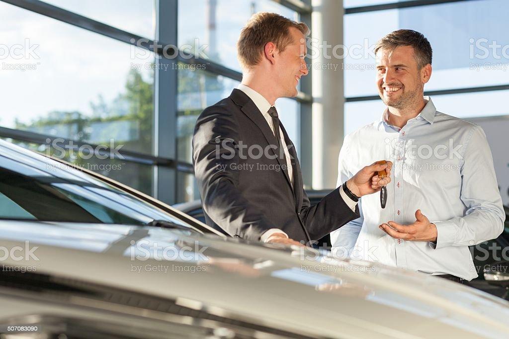 Car dealer selling car stock photo