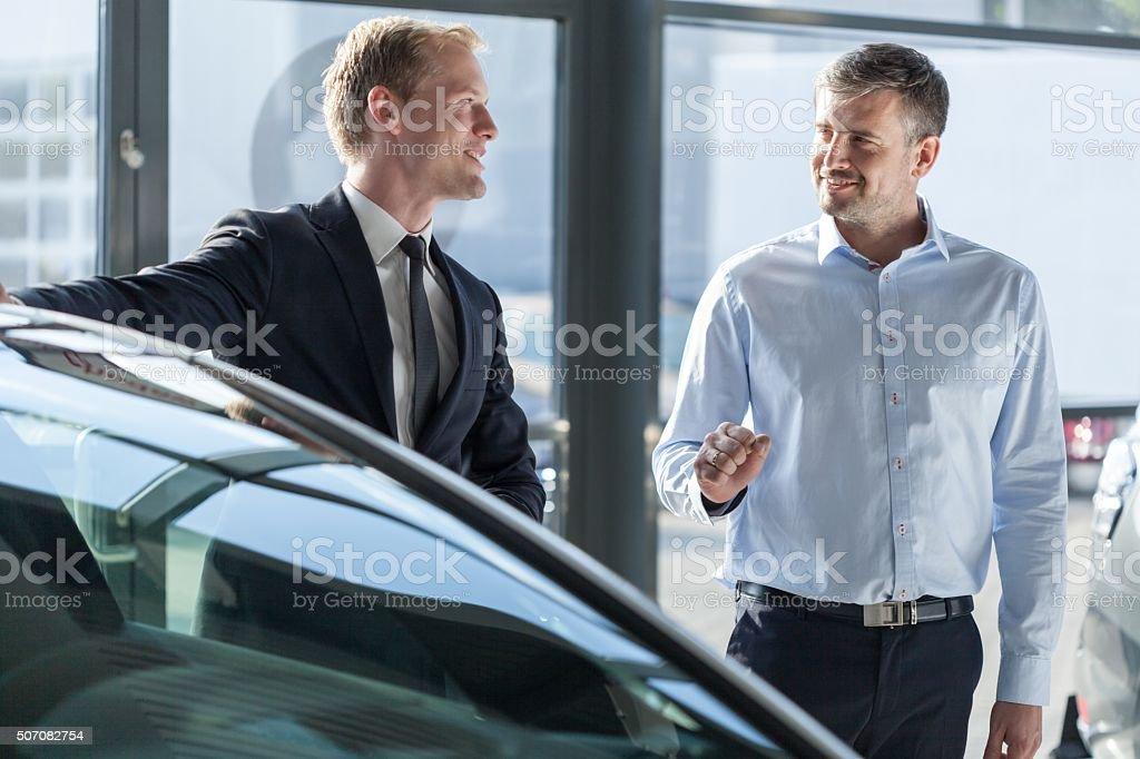 Car dealer showing vehicle stock photo