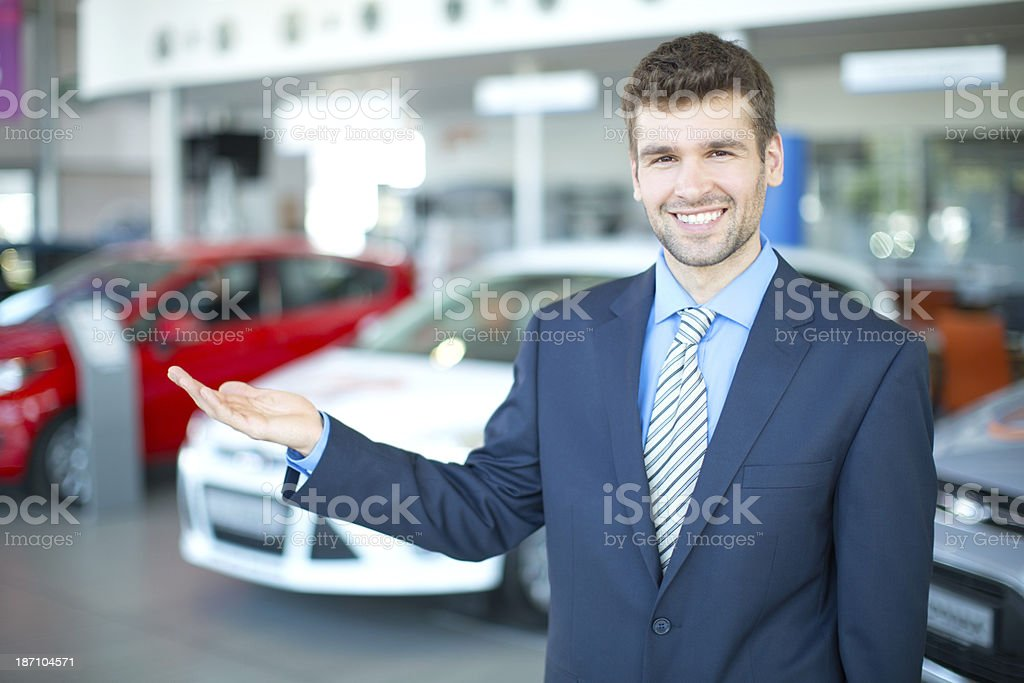 Car dealership sales person. royalty-free stock photo