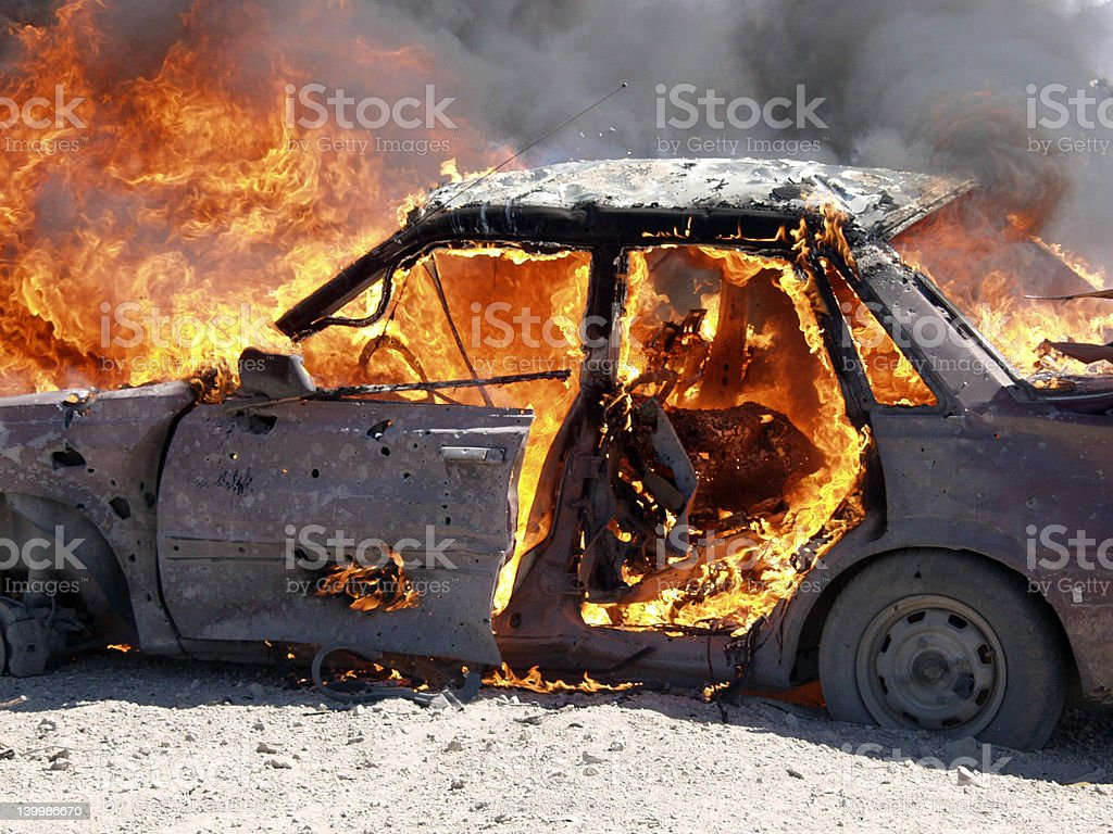 Car Destroyed by Explosion royalty-free stock photo