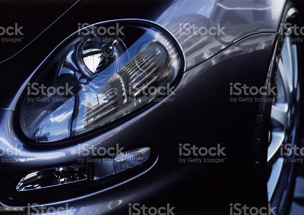 Car detail with a building in the headlight royalty-free stock photo