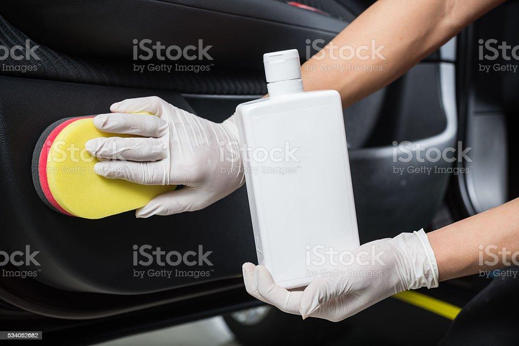 Car detailing series : Cleaning car door panel stock photo