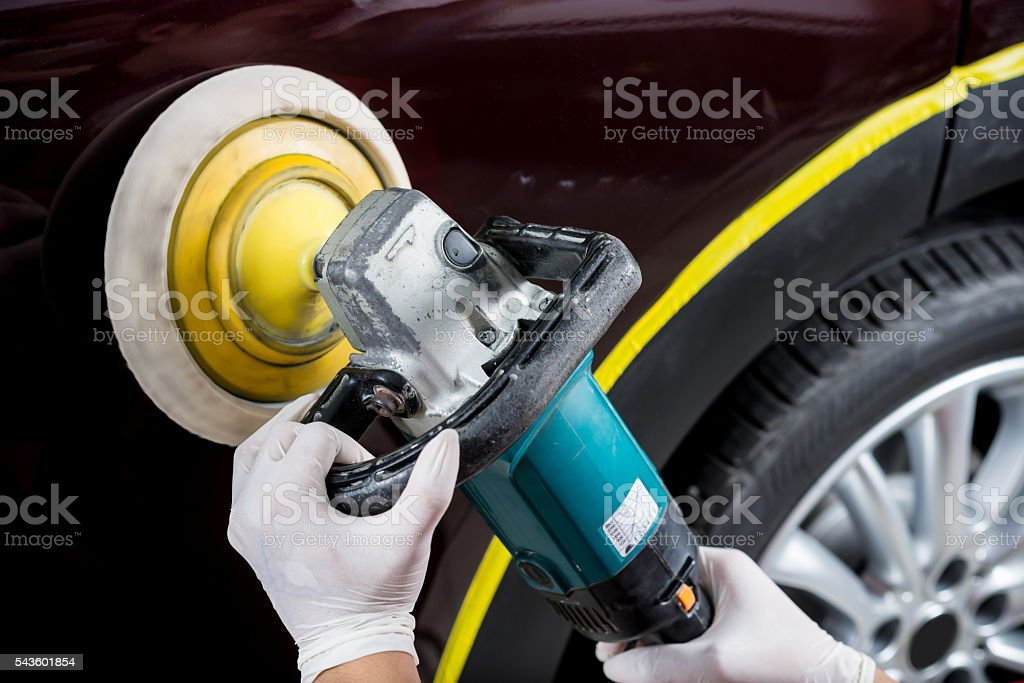 Car detailing series : Polishing brown car stock photo