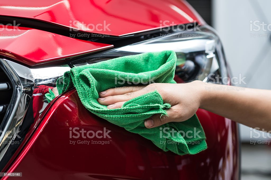 Car detailing series : Polishing red car stock photo