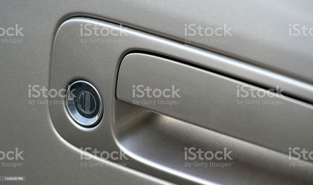 Car door handle and keyhole royalty-free stock photo